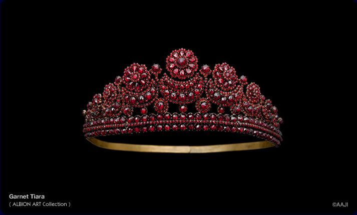A heavily encrusted garnet and gold tiara, with circular flower heads on creacent moon motifs. Now with Albion Arts, Japan.