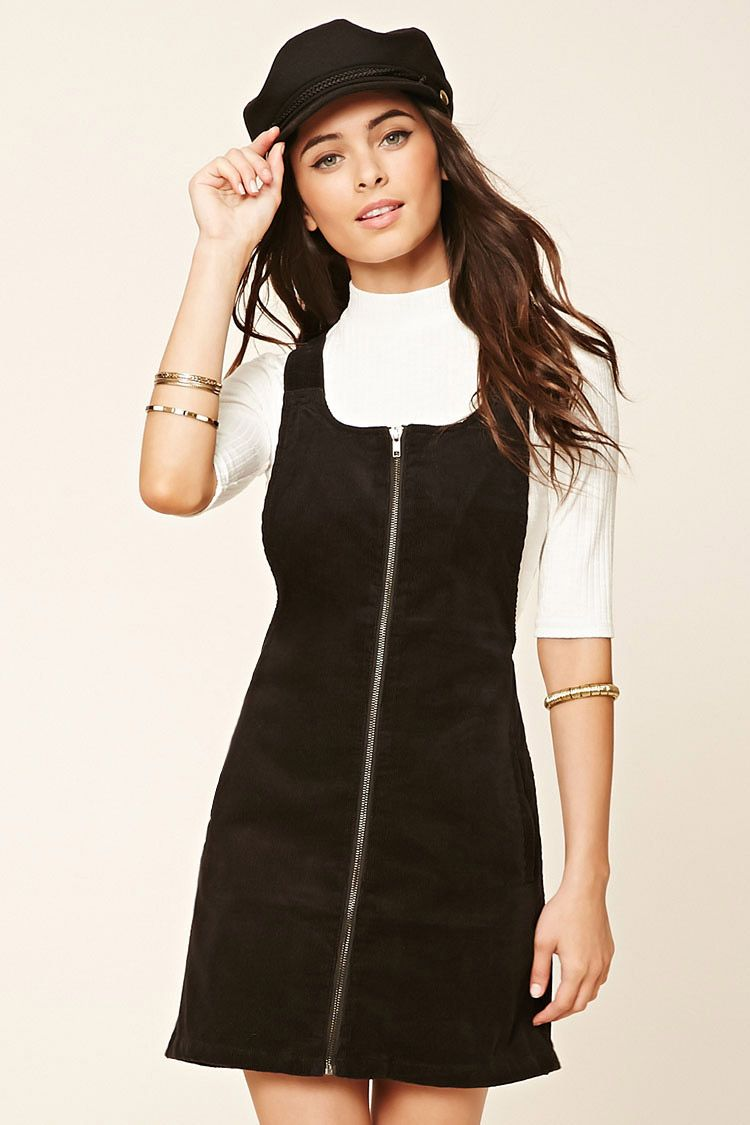 773614dbb88 A corduroy overall dress with an exposed zippered front
