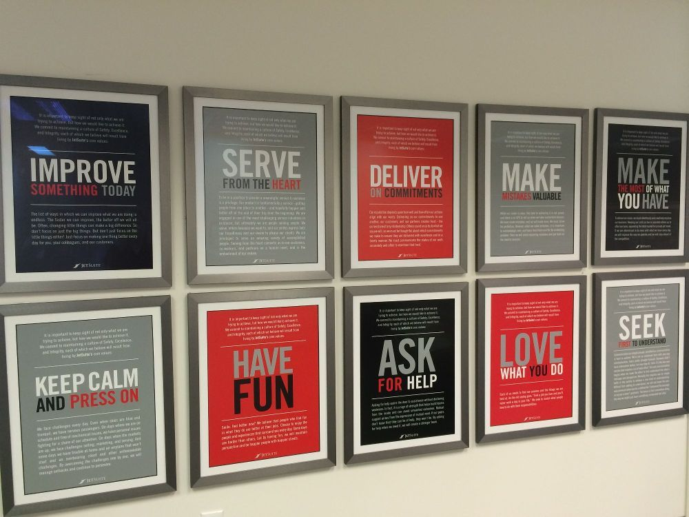Framed posters of JetSuite values in hallway - JetSuite - Irvine ...