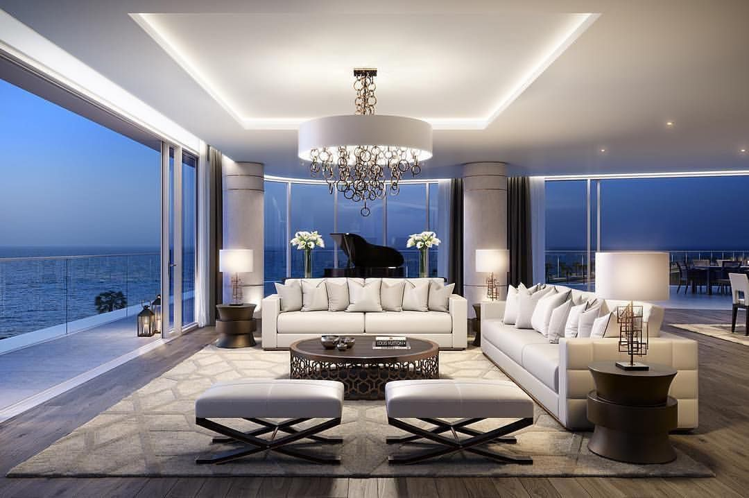 White living room with beautiful ocean views and the for Grand piano in living room