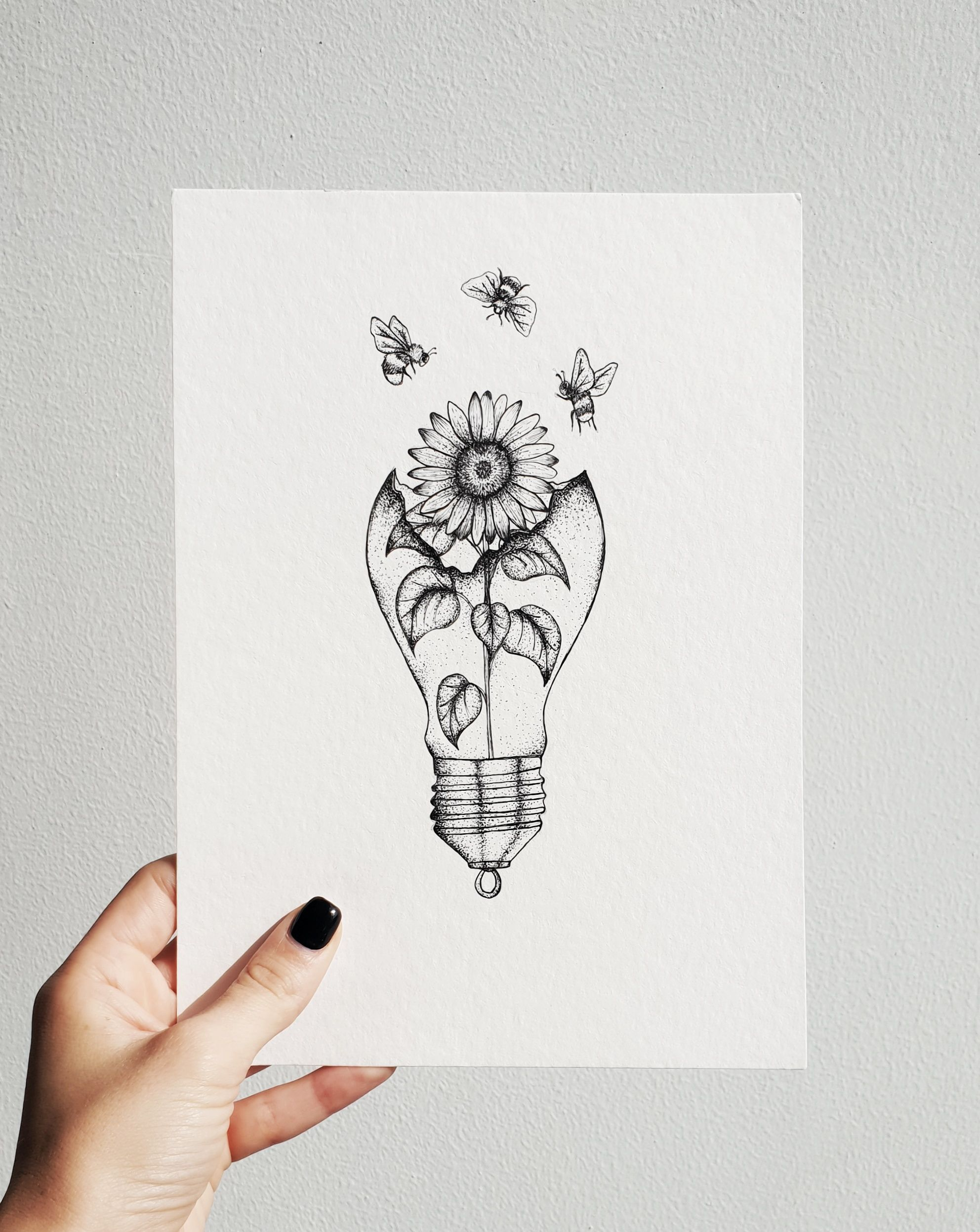 Photo of Sunflower in a light bulb tattoo design