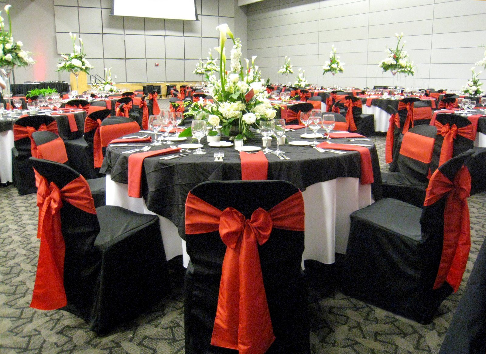 Black chair and white chair - Wedding Receiption Tables Wtih Black Red And Ivory Shown With Black Chair Covers With