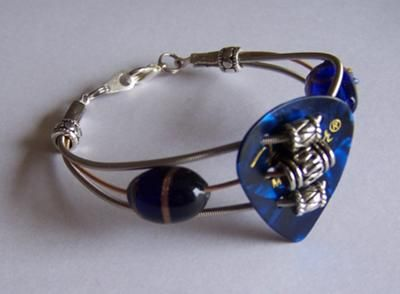 Three Guitar Strings Bracelet in Cobalt and Silver  by Joyce Roseman.  I love the pick too! high school art camp...