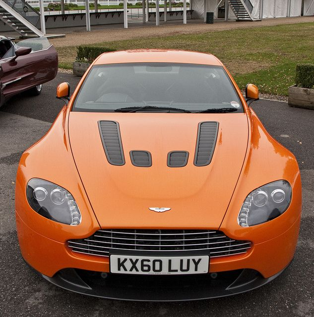 Aston Martin V12 Vantage.  One of the few cars that look stunning in orange.  LOVE!!