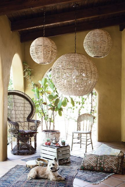 Boho Chic Patio Area With Beauitful Oversized Pendant Lights
