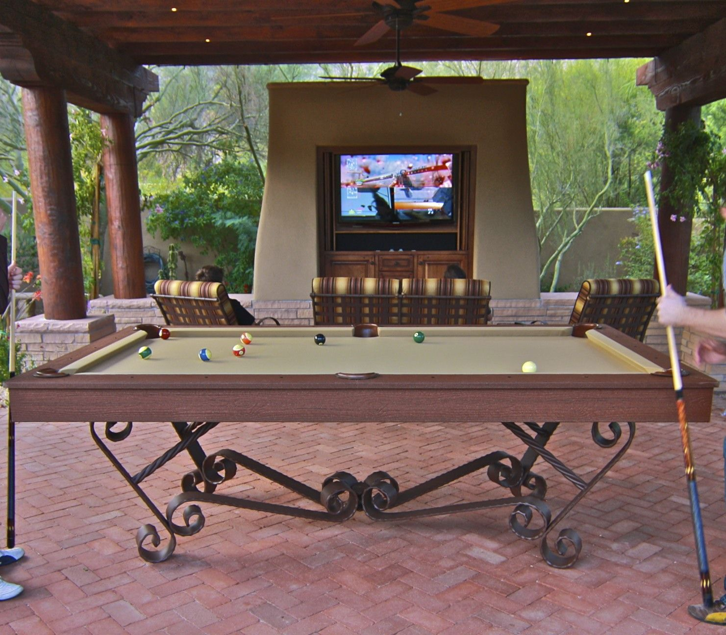 Pool table outdoors how awesome but adjust shots for for Garden pool table room