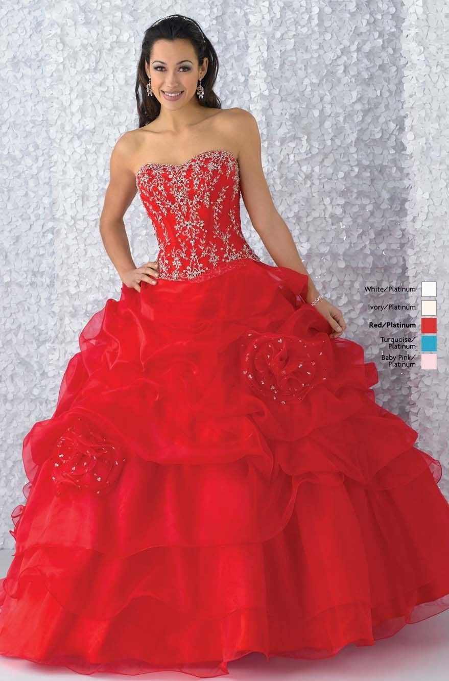 b44fe9c0439 Description  Red gown with beaded bodice. Billowy organza skirt accented by  scattered rosettes