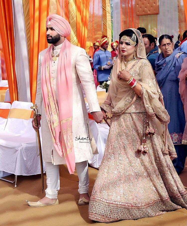 A pale pink and blush pink color coordinaed sikh groom n bride ...