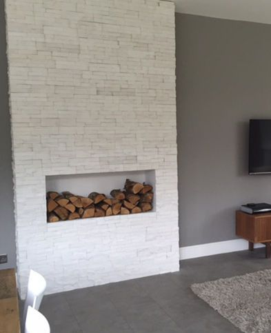 White stone veneers used to create a faux chimney breast for Tiled chimney breast images