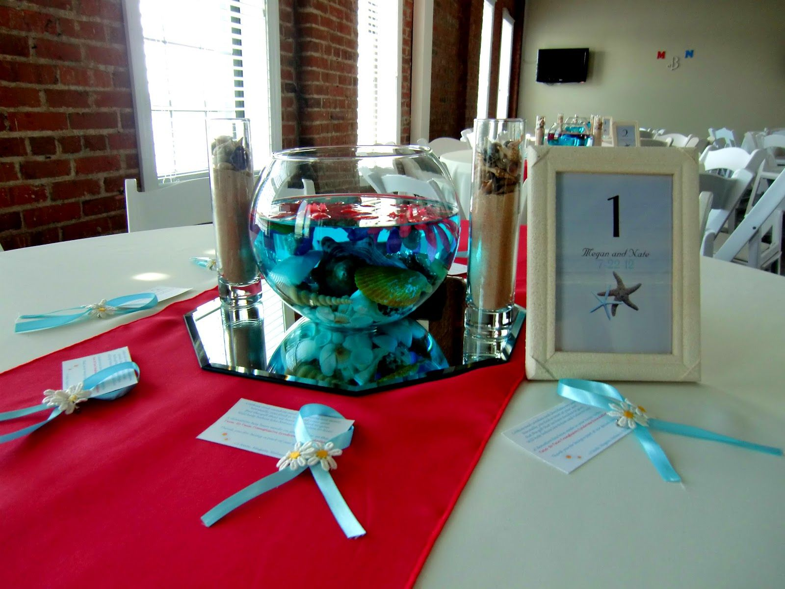Beach themed wedding reception  Blue KoolAid was used to dye the water blue for this beach themed
