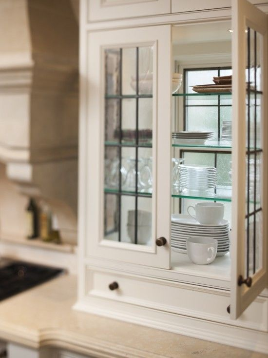 Detail Of Leaded Glass Cabinets Set In Front Of Existing Window