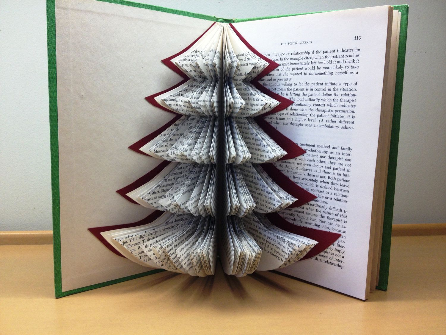 Christmas Tree Recycled Book Art Strategies Of By Pacifictides Old Book Crafts Folded Book Art Book Crafts