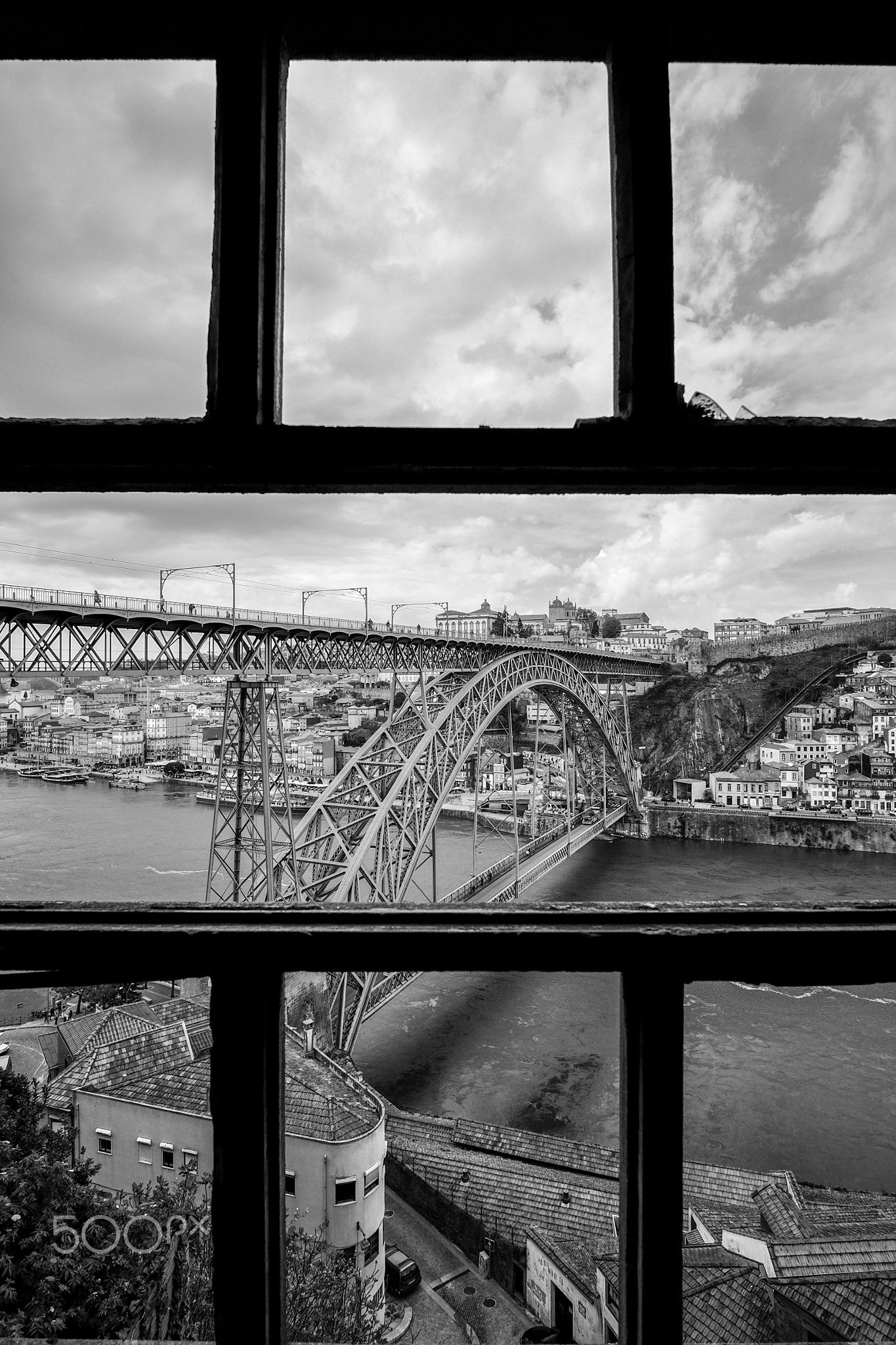 Rear Window - Definitely not a place you should find and visit, as it's an abandoned building in really bad shape. But it does provide one of the best rear windows to the city of Porto. Especially on cloudy days.  So yes, that's an actual window. And the actual view.