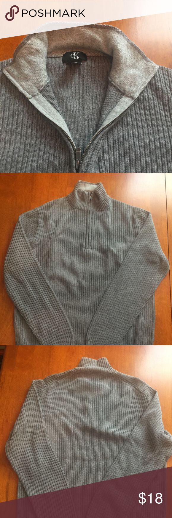 WINTER❄️SALE Calvin Klein Large Sweater Calvin Klein men's sweater.  Color is grey and size is large.  1/4 zip in front.  Item is in very good condition. Bundle to save on shipping. Calvin Klein Sweaters Zip Up