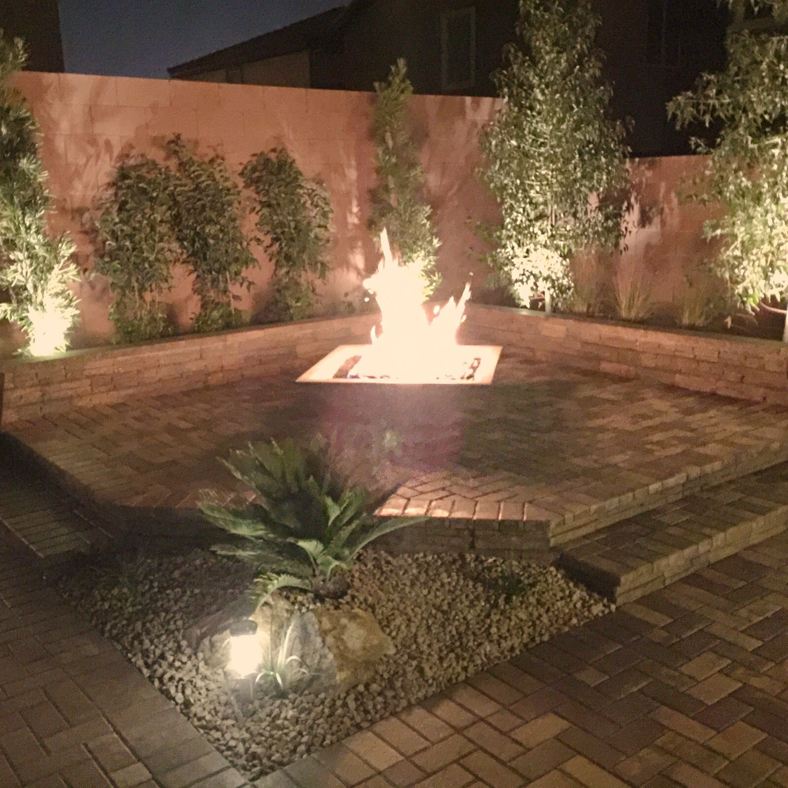 Backyard fire pit designed and installed by Land View Landscape