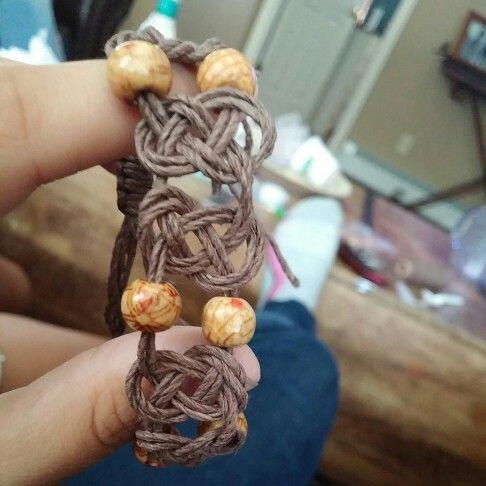 Adjustable pretzel knot hemp bracelet.