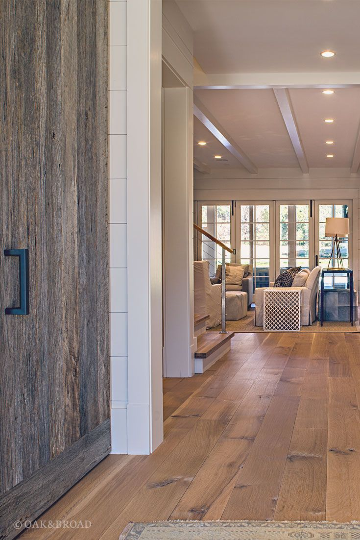 Wide Plank White Oak Hardwood Floor By And Broad With Custom Stain Reclaimed Wood Iron Hardware Add A Sense Of Drama To This Rustic Modern Home