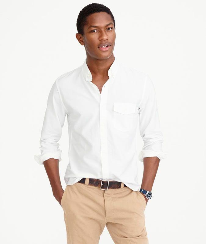 Man wearing a white oxford shirt and khaki chinos