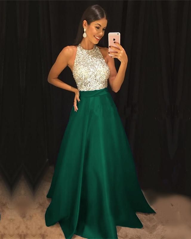4cc1669c5f6 Dresses Video Shows Item Description   A Glamorous Long Halter Satin Dresses  With Sequins and beaded top which makes it perfect for your prom