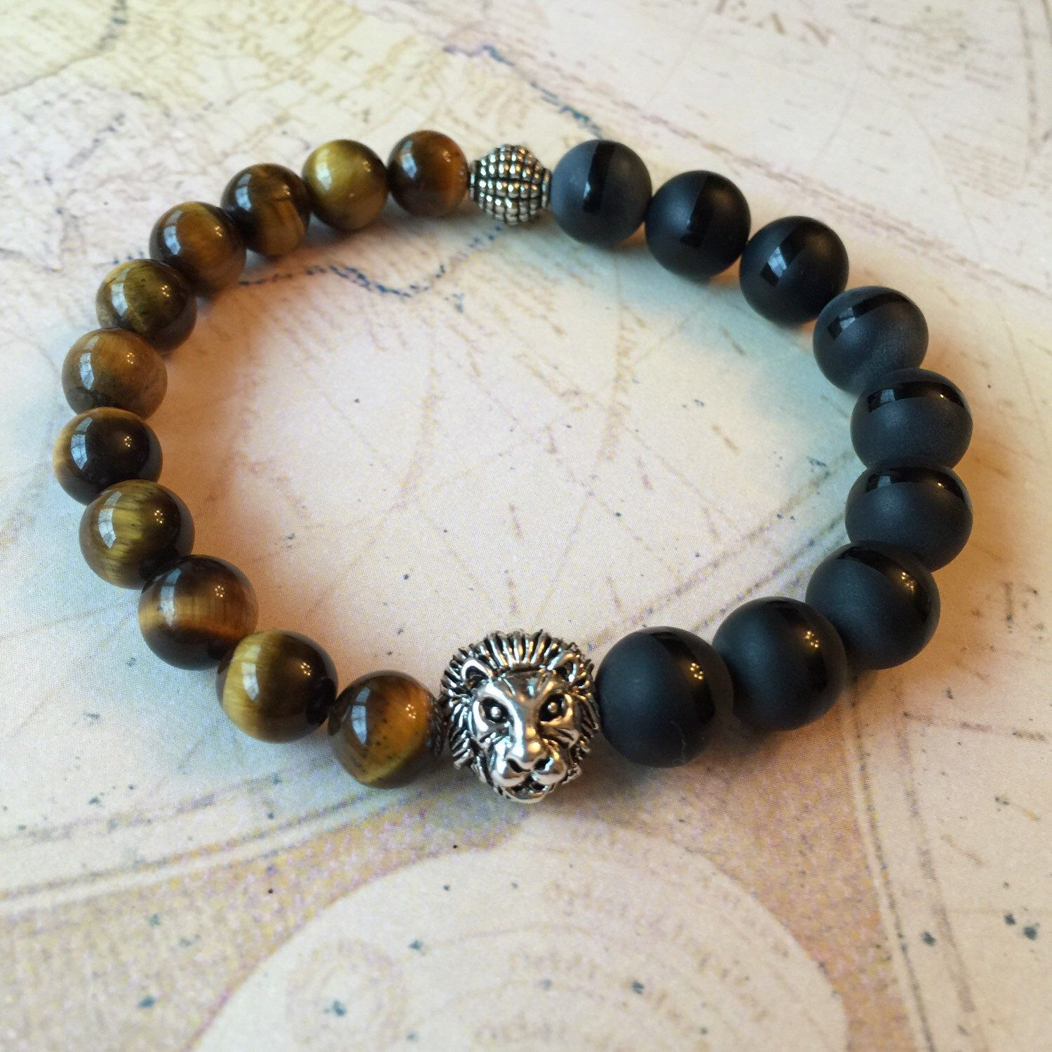 A personal favorite from my Etsy shop https://www.etsy.com/listing/260454486/tigers-eye-agate-mens-fashion-wrist-mala