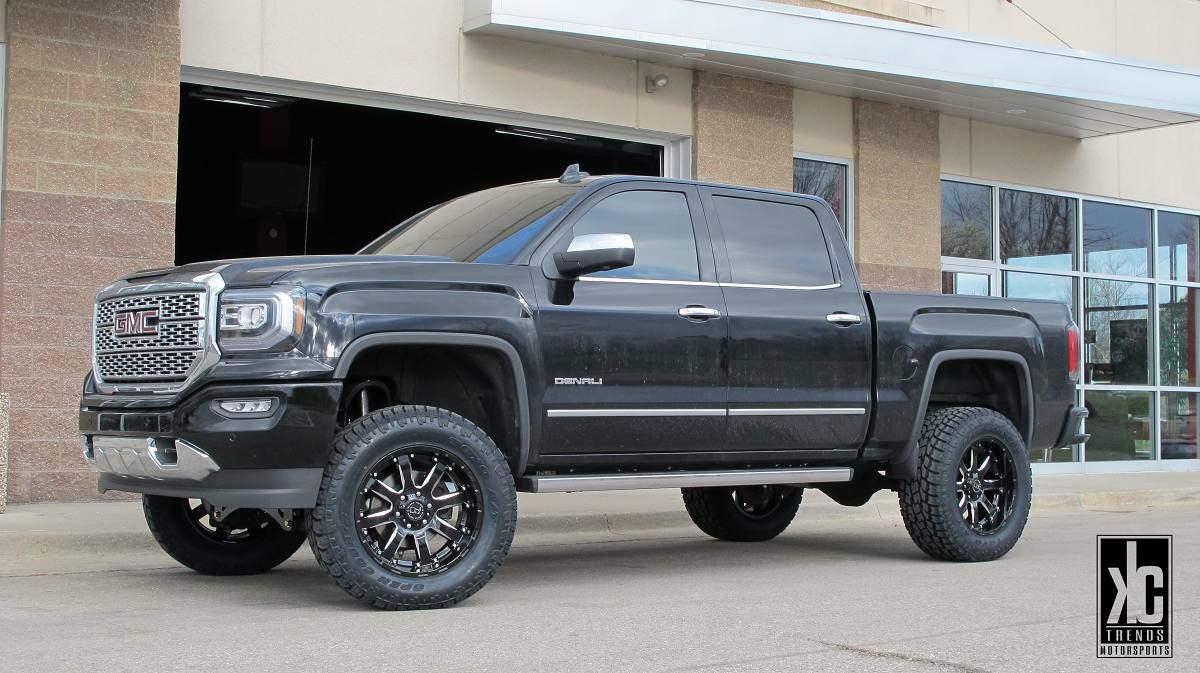 Black rhino sierra mounted with toyo tires and a fabtech suspension lift on a 2016 gmc