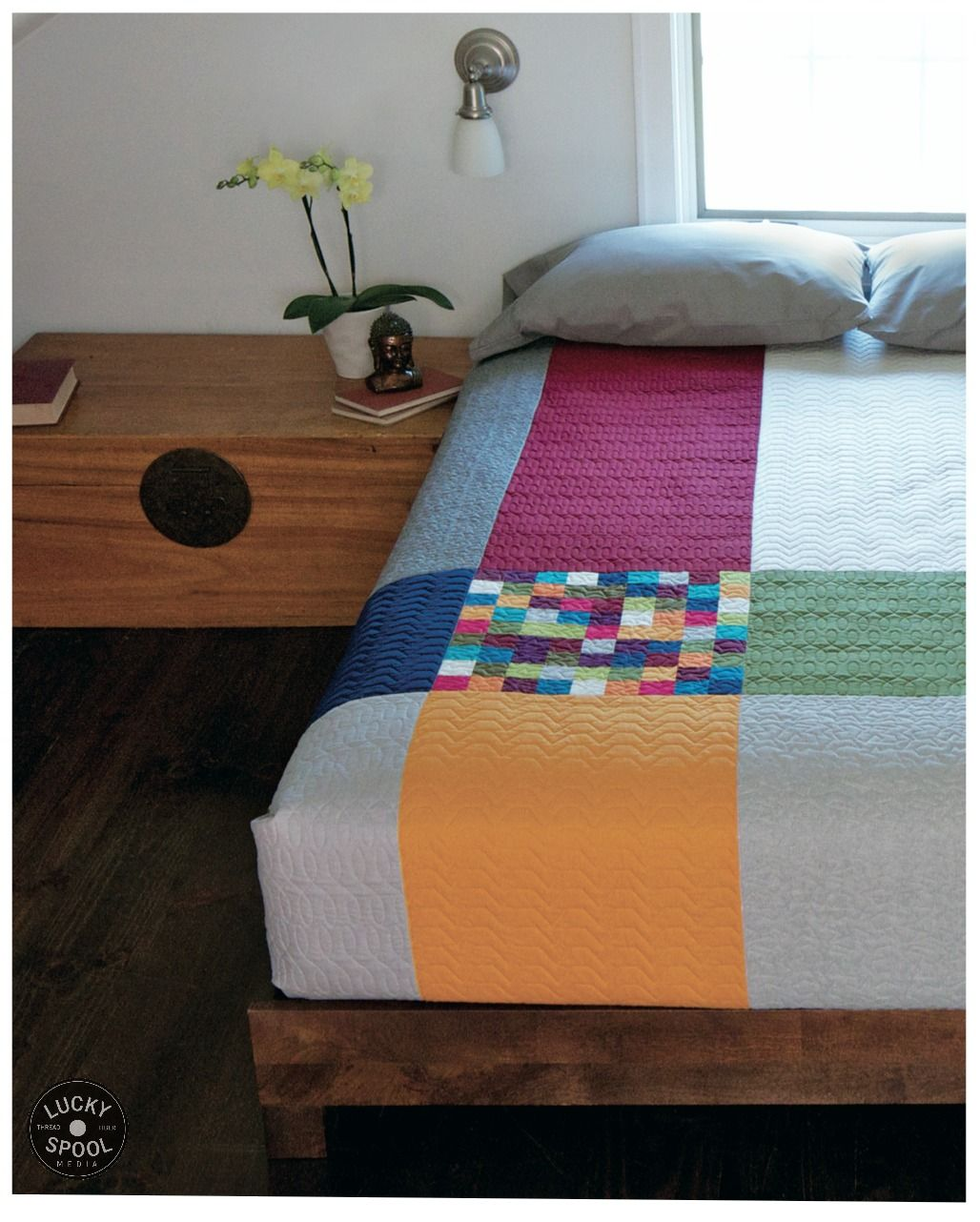 Minimal Style bedroom and quilt version 1 with patchwork detail from April Rosenthal's book. Photo (c) Gale Zucker
