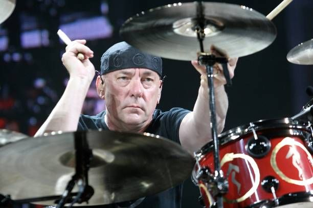 Drummer, musician and author Neil Peart is shown performing on stage...