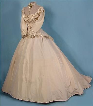 Ivory silk faille wedding dress with chenille fringe and tassel trim (front), American, 1868. Worn by Mrs. Alonzo H. Wood.