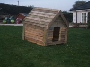 dog house made of pallets In the doghouse in a literal sense