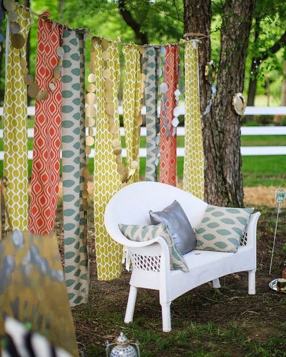 Lovely outdoor lounge setup  colorful backdrop for any event! #rentmyphotobooth Photo via #WeddingChicks #gypsysetup