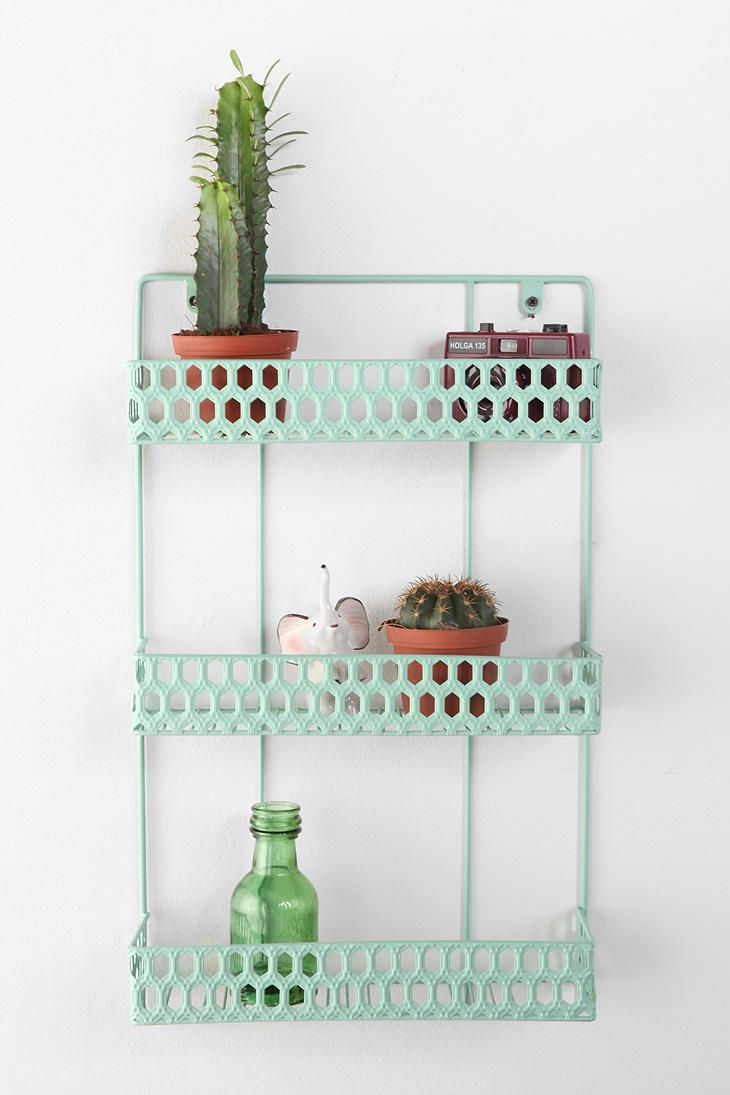 This mint green rack could be used for loads! Letters, herbs (fresh and dried) or maybe cookbooks!