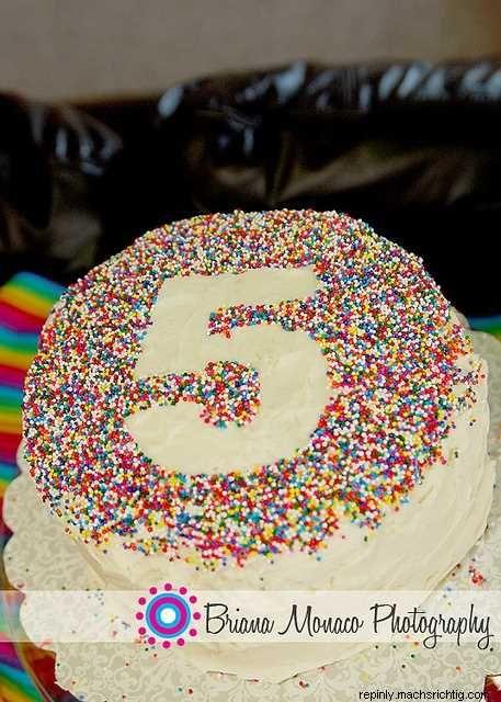 Place number on cake, sprinkle with sprinkles, rem