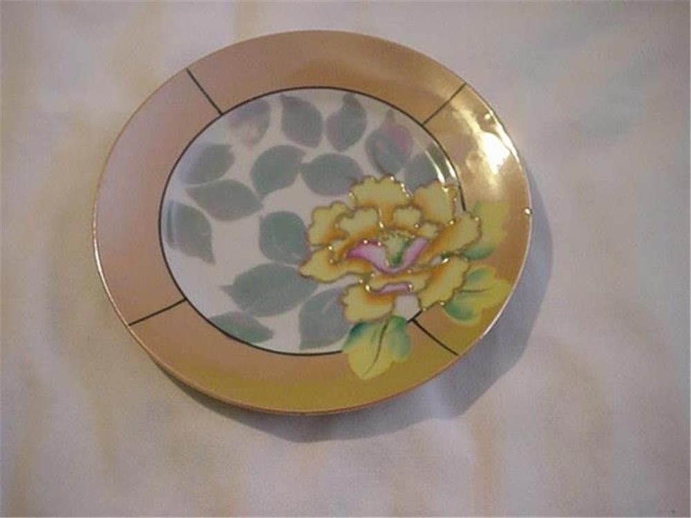 "I got this plate at a garage sale though and it is such a pretty one, well, consider this a rescue. It measures 7"" in diameter, will look wonderful on a wall in a display. This would have originally been part of a tea/dessert set. 