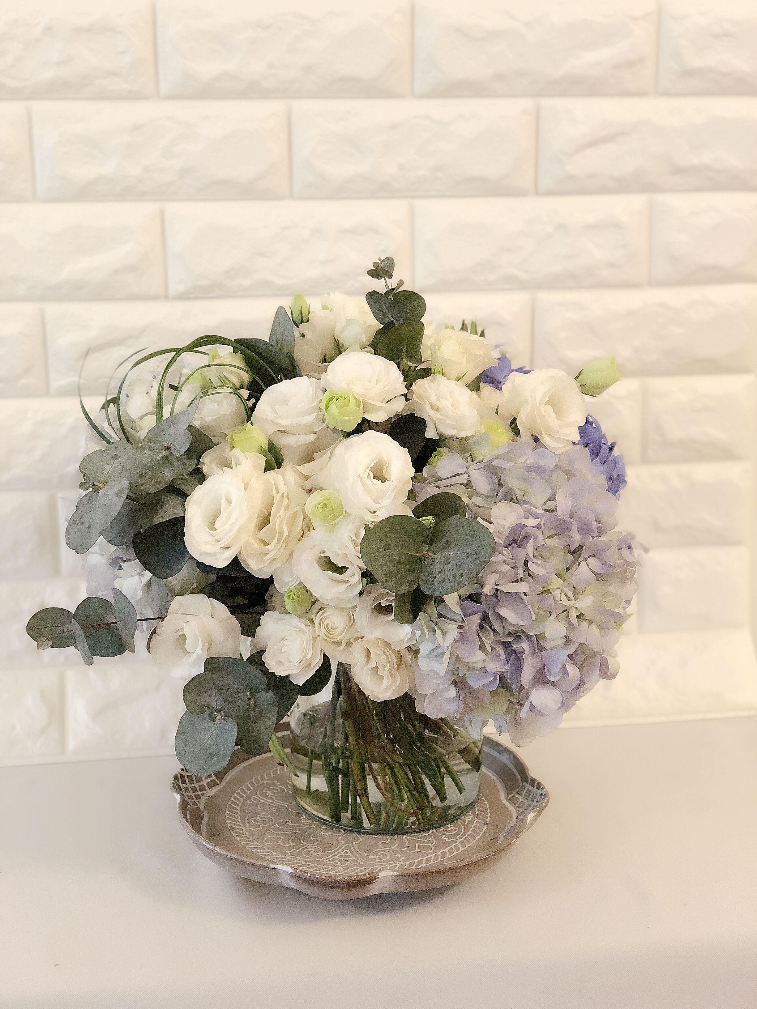 Blue hydrangea white lisianthus eucalyptus flower bouquet