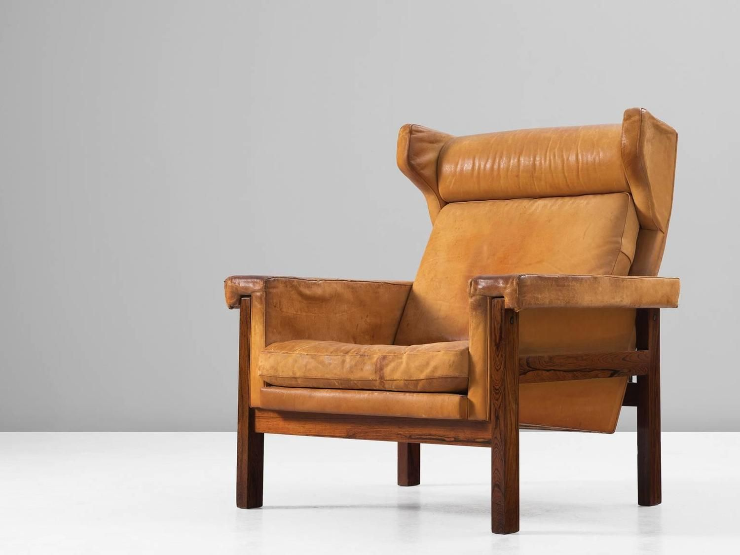 Of four chairs in oak and patinated cognac leather for sale at 1stdibs - Danish Wingback Chair In Solid Rosewood And Patinated Cognac Leather