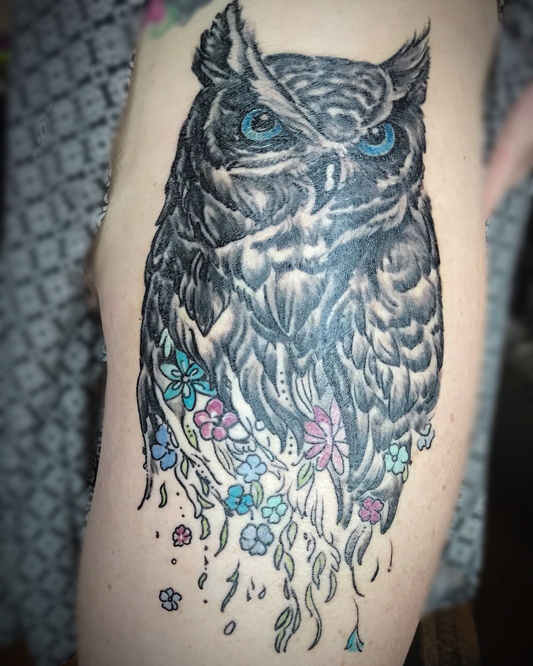 Owl tattoo. Realistic, badass, blue eyes, fade to flowers