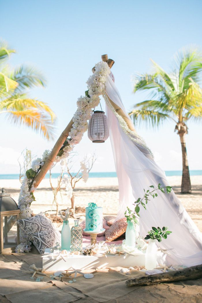 Tent In Boho Style Decorated With Flower Garlands Lanterns Cushions And Bottles On A Boho Beach Wedding Beach Wedding Inspiration Beach Wedding Decorations