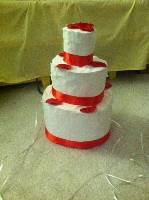Cake Pinata - Great for bridal showers! I made this out of poster board, tissue paper, ribbon, & fake rose petals. (not the best photo, but you get the picture)