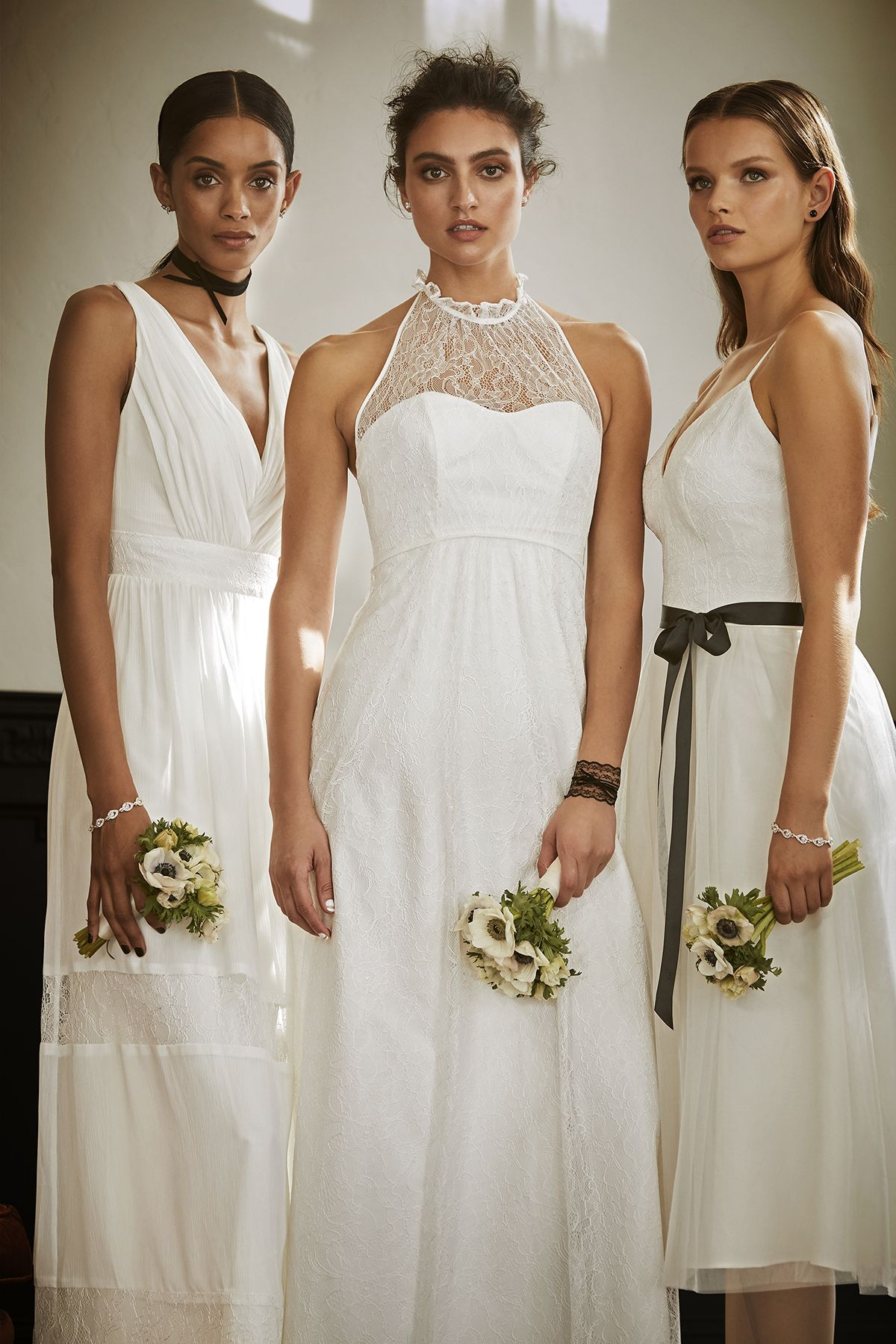 The All White Bridal Party In Favor Of White Bridesmaid