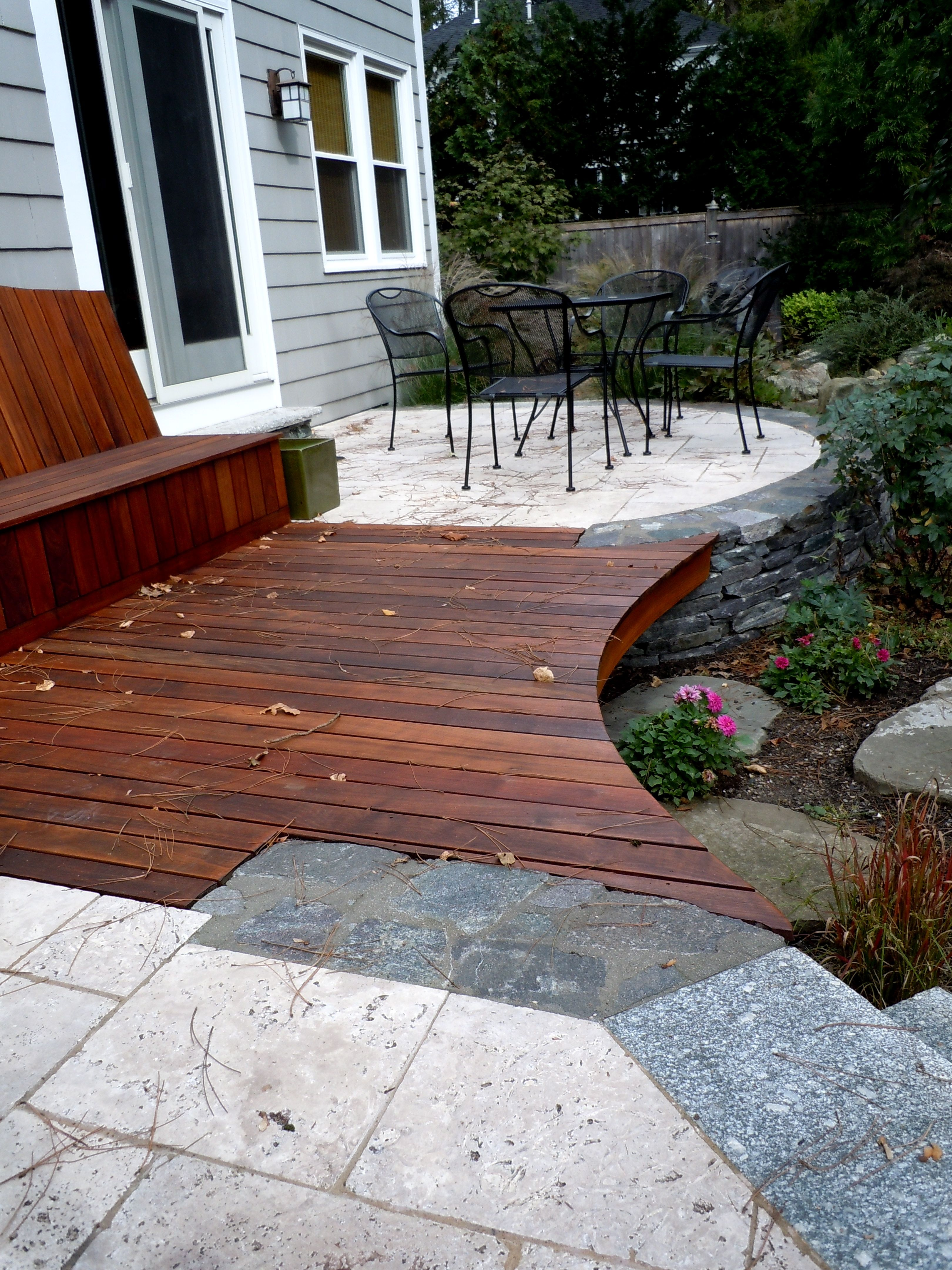 Good Unique Raised Patio Construction With A Wooden Walkway