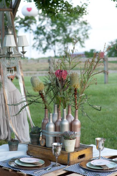 Outdoor party idea Spray painted bottles for centerpiece Party