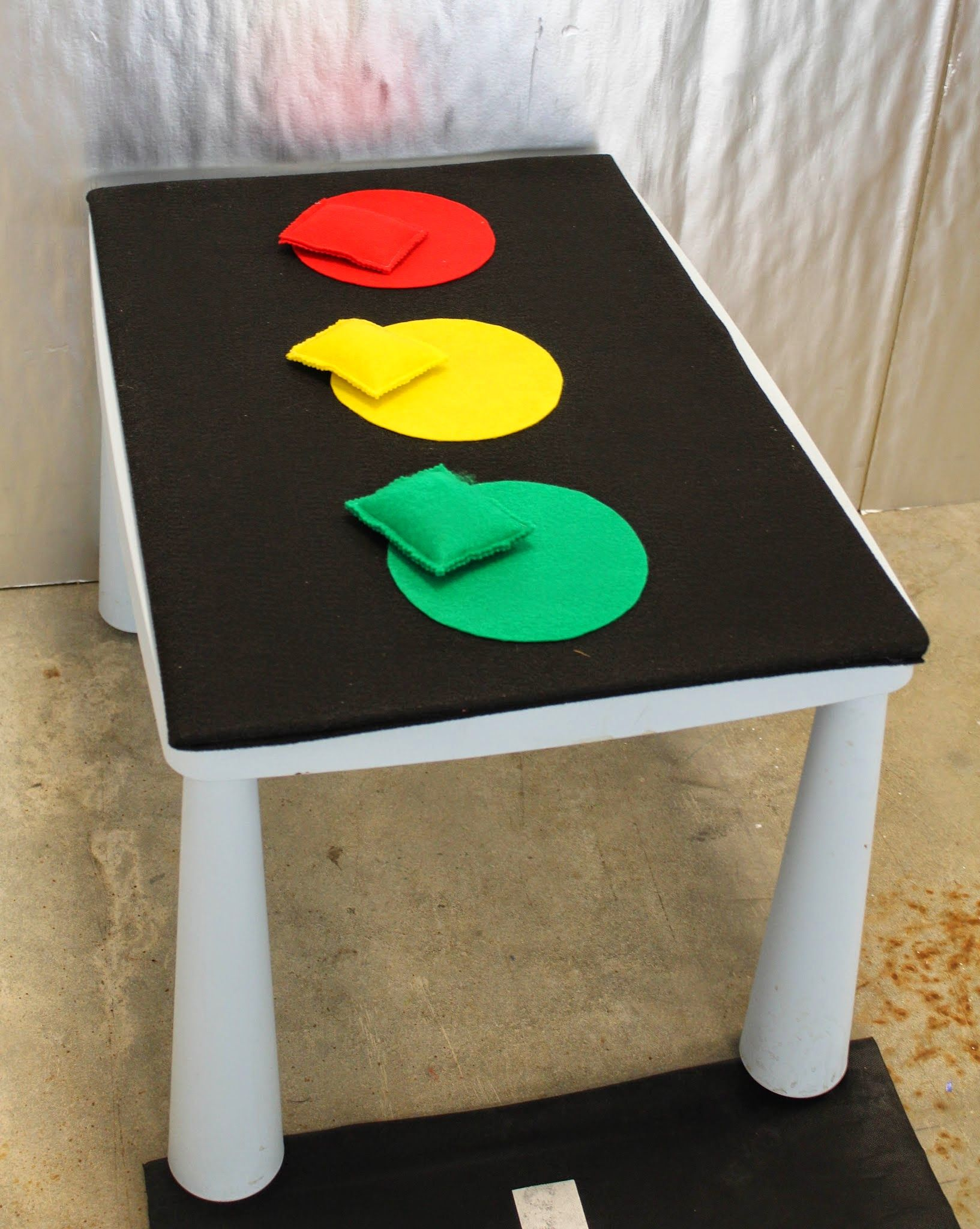 Toss the bean bag on the right color of the stop light. Easy and fun for any toddler.