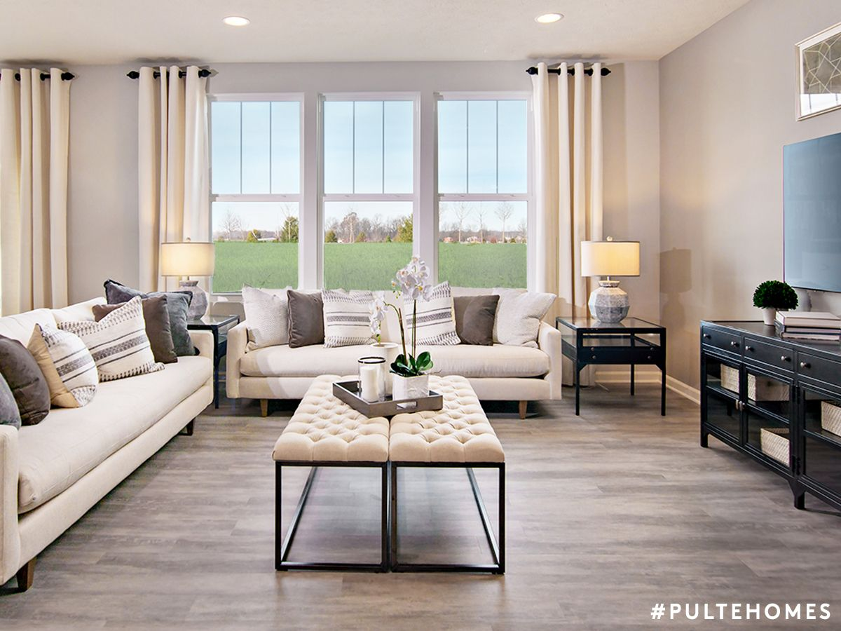 A neutral living room with entertaining space