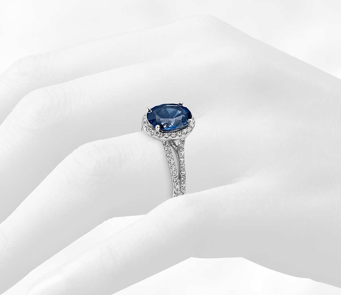 7e0155d4af76d Oval Sapphire and Diamond Halo Split Shank Ring in 18k White Gold ...