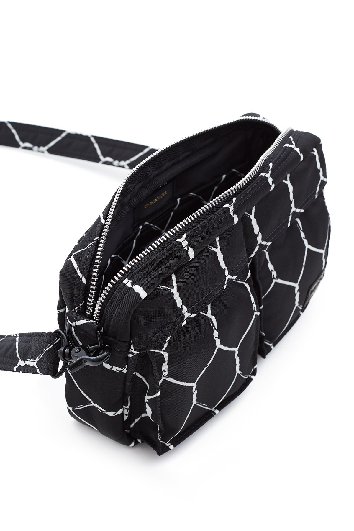 Wire fence print:Top zipper closure:Two front buttoned pockets with ...