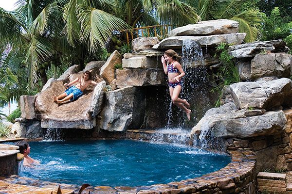 Really awesome backyard pool! I would love to have the waterslides with the  'natural' looking rock! - Front Yard Water Feature With Backyard Pool Remodel With Natural