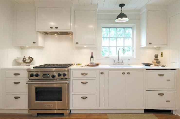 Classic cottage galley kitchen with white plank ceiling and hardwood kitchen floor. #whitegalleykitchens Classic cottage galley kitchen with white plank ceiling and hardwood kitchen floor. #ikeagalleykitchen