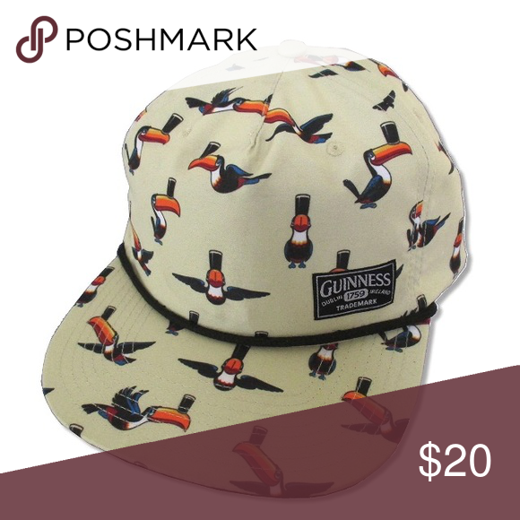 a8caffde837c6 Cream colored hat with classic Guinness Toucans printed all over. Flat Bill