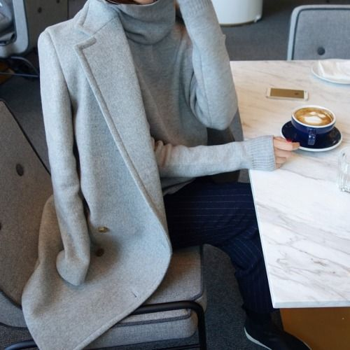 Latte time with turtlenecks and gray coats.