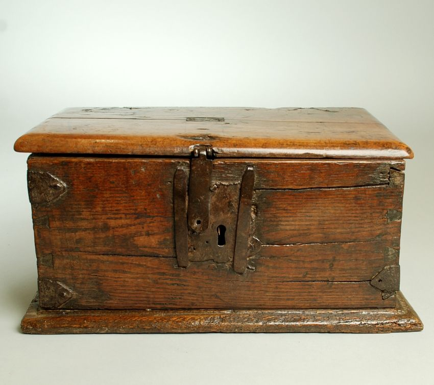A handsome 17th century English oak strongbox with original iron hardware, strap hinges and early patch repairs - circa 1650. Overall with excellent wear and patina.